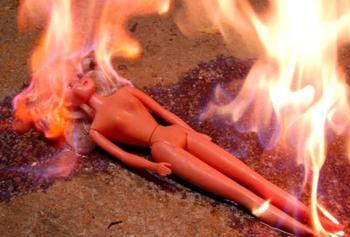 burn_barbie_burn_i_by_shwarzengel_400x271_xlarge